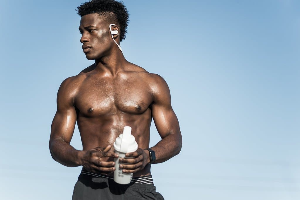 Man holding pre-workout shake