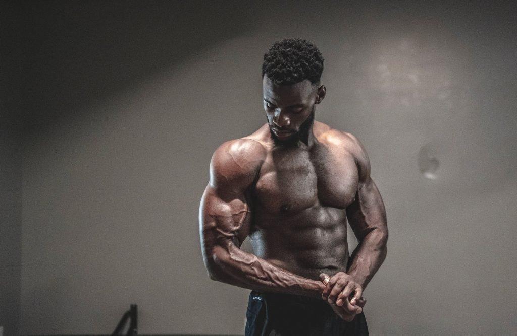 man flexing pecs and biceps