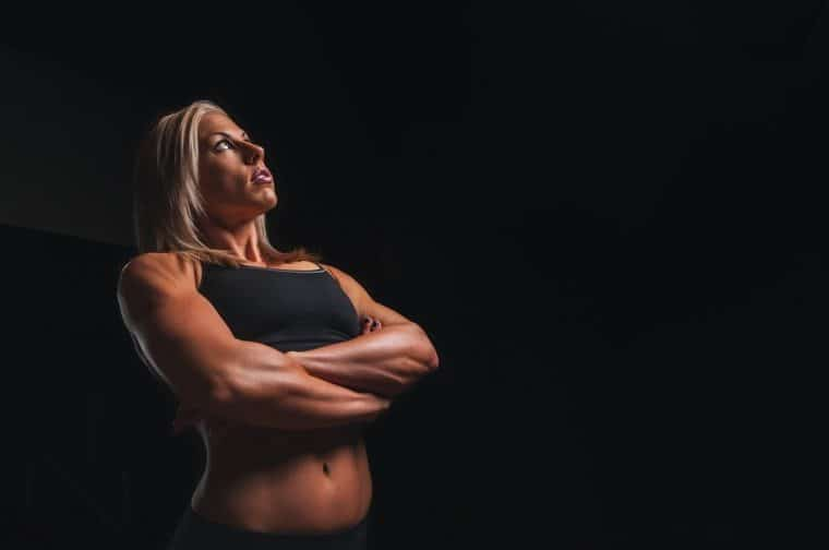 woman with muscle with arms folded