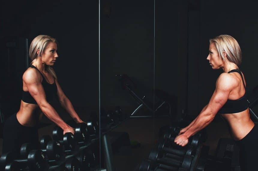 woman at dumbbell rack