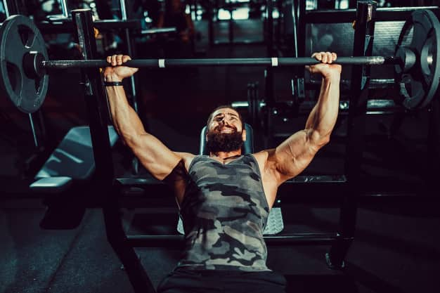 Man lifting weight on bench press